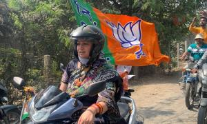 Bengal polls: Smriti Irani leads BJP rally on scooter