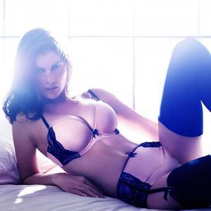 PICS: Laetitia Casta stuns in new lingerie campaign!