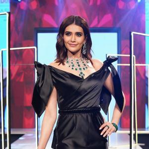 Bold! Karishma slays in a black off-shoulder gown
