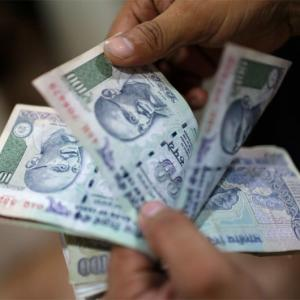 Rupee tumbles 20 paise on buoyant dollar, capital outflows