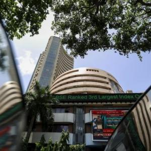 Late buying lifts Sensex, exit polls take centrestage