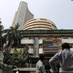 Markets end flat as trade tensions return; TCS gains on buyback boost