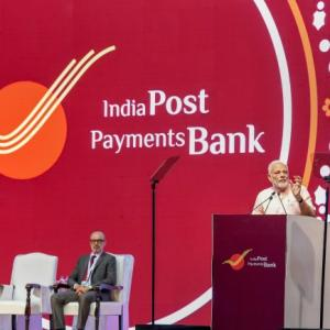What is drowned out in all the euphoria over India Post banks
