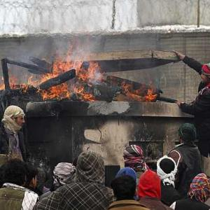 Anti-US stir in Afghan over Quran burning turns violent