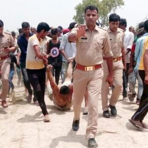UP police apologise after viral photo shows victim being 'dragged' in cops' presence