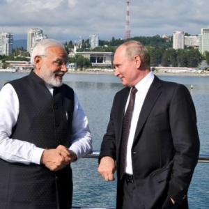 PHOTOS: Bear hugs, yacht ride as Modi meets Putin for first informal summit
