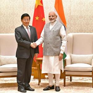 What was Xi Jinping's confidant doing in India?