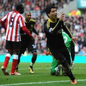 Slick Suarez seals Liverpool points