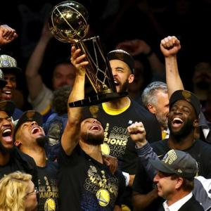 PHOTOS: Warriors rout Cavaliers to win second straight NBA title
