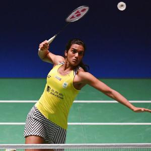 Sindhu advances; Saina crashes out in first round at China Open