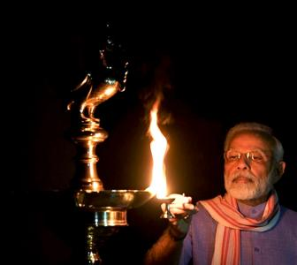 Indians light lamps to unite in fight against COVID-19