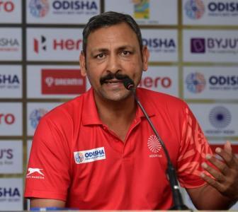 What's hockey coach Harendra doing at IGI Airport?
