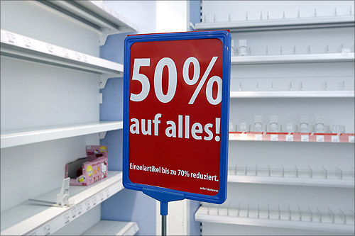 Empty shelves are pictured during the last day of the closing down sale at a Schlecker drugstore in Munich.