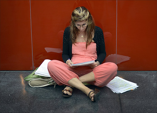 A woman studies before taking the Basque Government public health service (Osakidetza) exams at the Bilbao Exhibition Center (BEC) in Barakaldo.