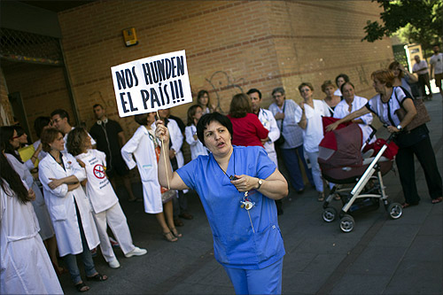 Public health workers take part in a protest against government austerity measures in Madrid.