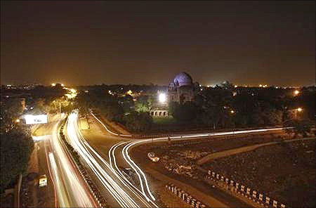 Traffic moves along a busy road after electricity was restored in New Delhi.