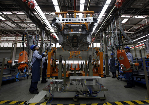Employees work at an assembly line in the new Ford Thailand manufacturing plant located in Rayong province, East of Bangkok.