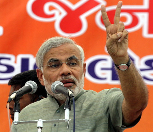 Gujarat's Chief Minister Narendra Modi gestures during an election campaign rally in Balasinor.