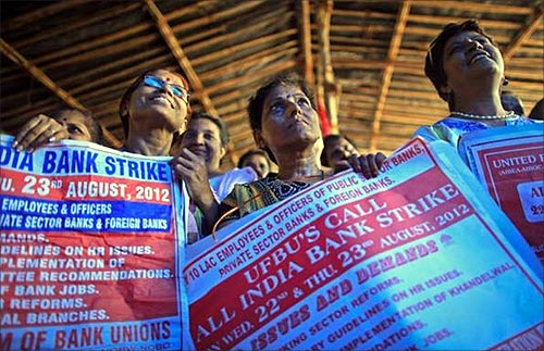 Bank employees hold placards at a rally during a two-day strike in Mumbai.