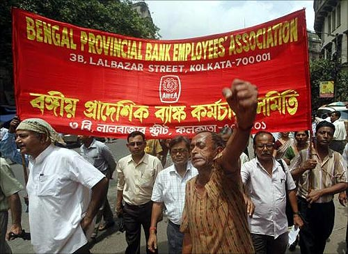 A bank employee shouts slogans while taking part in a rally during a two-day strike in Kolkata.