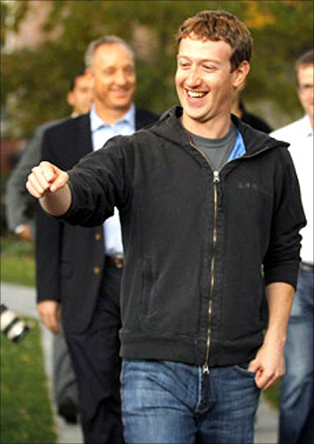 Mark Zuckerberg fist bumps a student at Harvard University in Cambridge, Massachusetts.