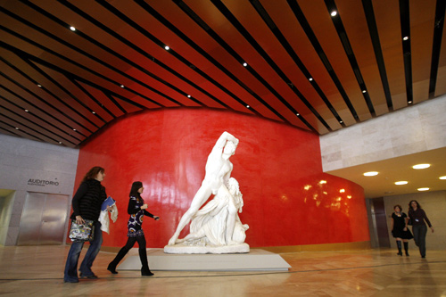 Visitors walk through the Prado Museum's new extension during a media presentation.