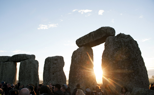 People attend the annual summer solstice at the Stonehenge monument on Salisbury Plain in Wiltshire, southern England.