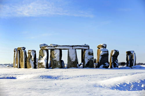 Fallen snow rests on Stonehenge in Salisbury, southern England.
