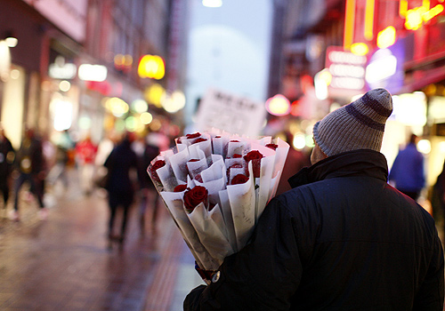 A man sells roses at a pedestrian road in central Copenhagen.