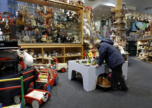 A boy looks at toys in Serneels toy shop in Brussels.