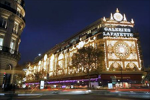 View of the Galeries Lafayette department store with Christmas lights in Paris.
