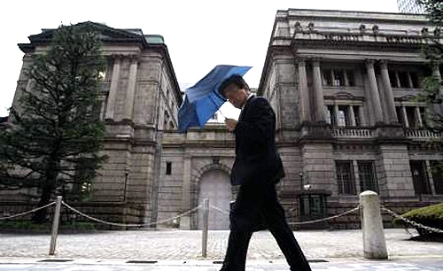 A man walks past the Bank of Japan building in Tokyo.