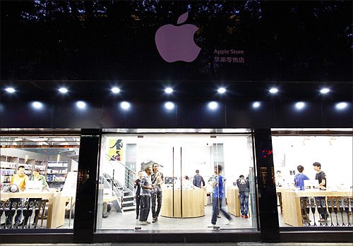 Customers and employees are seen from the exterior of a fake Apple Store in Kunming, Yunnan province.