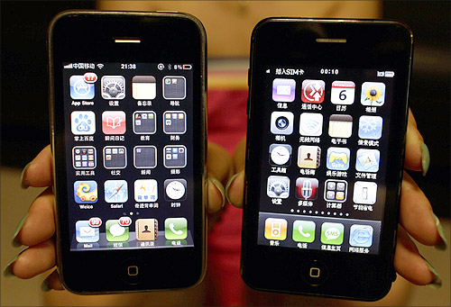 A posed picture shows a real iPhone 3GS alongside a fake model, in Beijing.