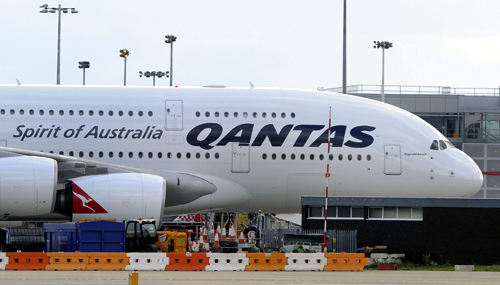 A grounded Qantas aircraft is seen parked at Heathrow Airport in west London.