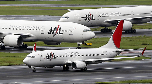 Japan Airlines (JAL) aircrafts are seen on the tarmac at Haneda airport in Tokyo.