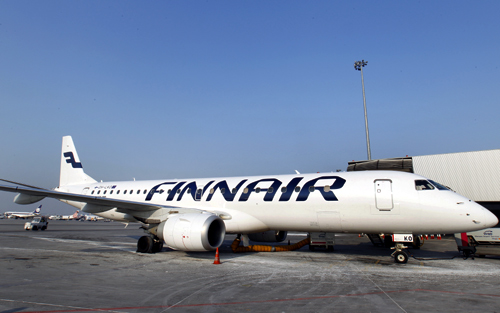 Finnair airplane is docked at the Chopin International Airport in Warsaw.