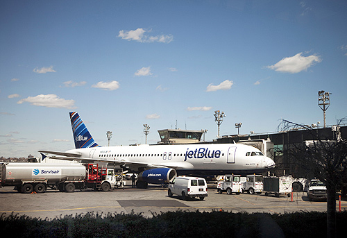 A JetBlue Airways plane awaits take off at LaGuardia Airport in New York.