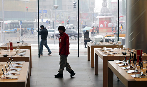 A staff walks inside an Apple store during the release of iPhone 5 in Beijing's Wangfujing shopping district.