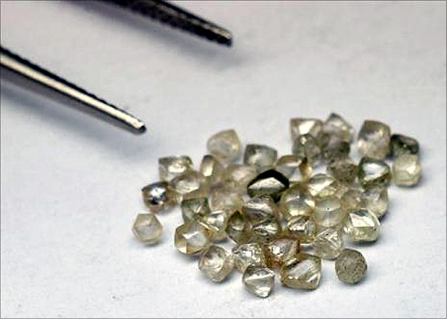 Rough diamonds are seen on the desk of a trader in his office in Santa Elena de Uairen in the south of Venezuela.