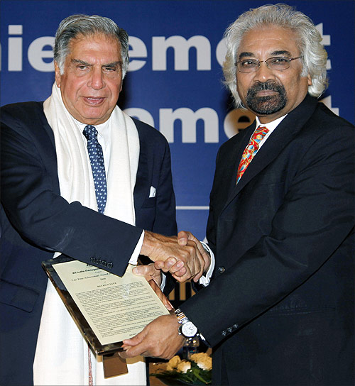 Ratan Tata, chairman of the Tata Group, receives the lifetime achievement award for management from Sam Pitroda, advisor to the Prime Minister of India on public information, infrastructure and innovation, conferred by the All India Management Association in 2011.