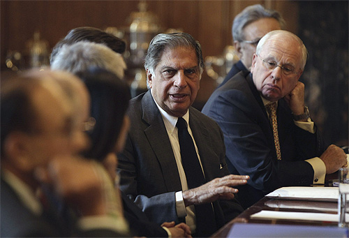 Chairman of Tata Sons Ratan Tata (C) speaks during a