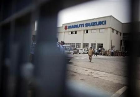 A policeman walks inside the premises of Maruti's plant in Manesar.