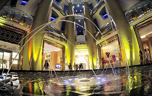 Guests walk past one of the fountains at the Burj Al Arab hotel in Dubai.