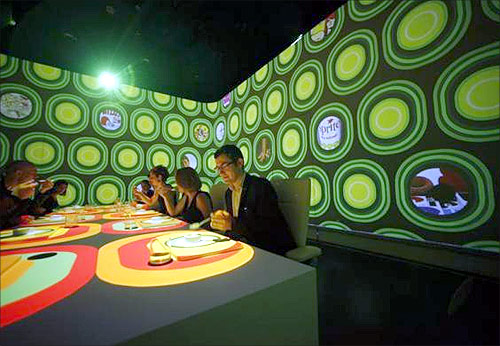 Guests attend a dinner at Ultraviolet restaurant in Shanghai.