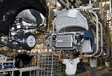 Workers assemble a car at a Maruti Suzuki plant in Manesar.