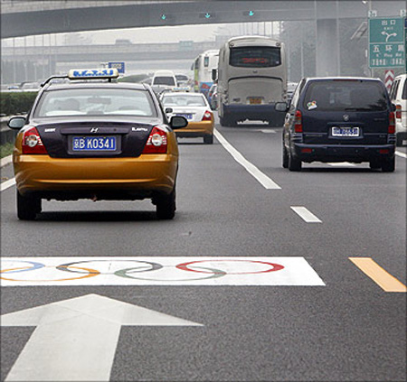 Vehicles past along a special Olympic lane at an airport expressway in Beijing.