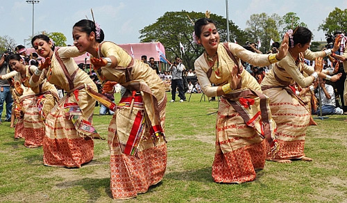 Youth in traditional Assamese attire perform Bihu dance during a programme organised to celebrate Rongali Bihu, at Judge's Field in Guwahati.