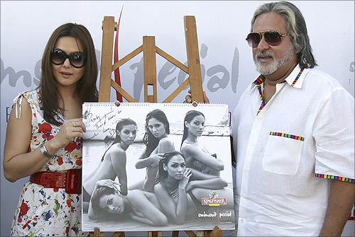 Bollywood star Preity Zinta (L) and Vijay Mallya, chairman of United Breweries group, unveil Kingfisher's new Swimsuit Special 2007 calendar in a function in Mumbai.