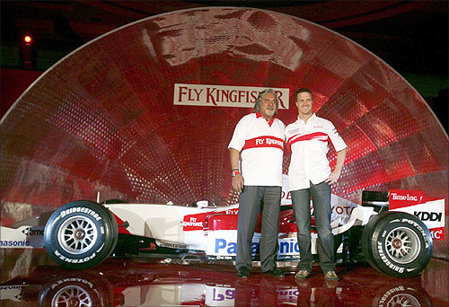 Vijay Mallya (L), Chairman and Chief Executive Officer of Kingfisher Airlines Ltd and Toyota's Formula One driver Ralf Schumacher of Germany.